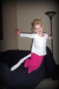 Photo of our daughter jumping off the couch