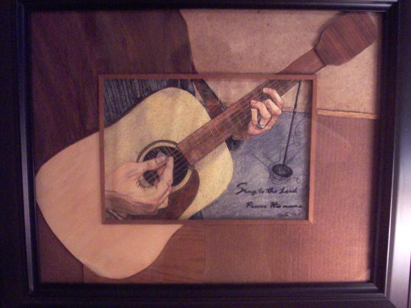 One-of-a-kind art piece: a sketch of my hands playing guitar with a very unique and creative wood matting.