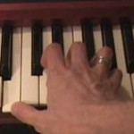 Hand playing a KORG Keyboard